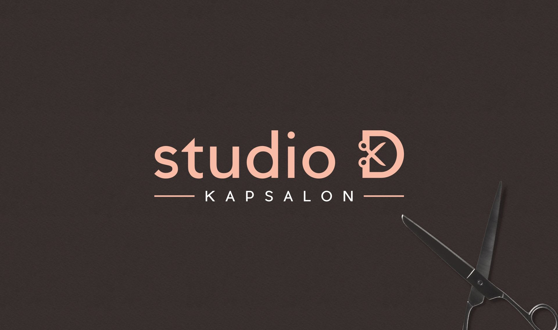 Studio D logo with scissors